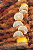 Fried fish with lemon slice Royalty Free Stock Image