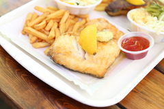 fried fish with lemon on top Royalty Free Stock Photos