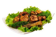 Fried fish on lettuce Royalty Free Stock Photo