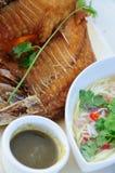 Fried fish. With mango salad Royalty Free Stock Image