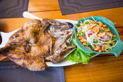 Fried fish with Mango Salad Royalty Free Stock Photo