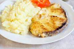 Fried fish and mashed potatoes Stock Images