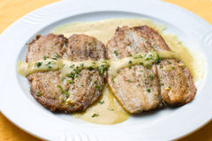 Fried fish with mustard sauce Stock Photo