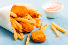 Fried fish nuggets with French fries Stock Photo