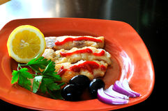 Fried fish and olives Stock Image