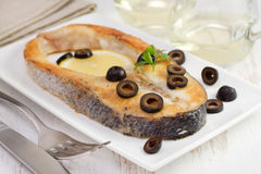 Fried fish with olives Stock Images