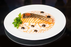 Fried fish with olives Royalty Free Stock Photos