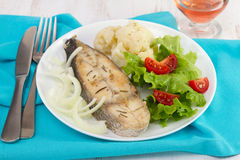 Fried fish with onion, boiled cauliflower Royalty Free Stock Photography