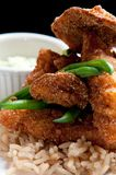 Fried fish over rice Stock Photo