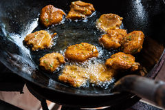Fried fish patty is fried in boiling oil. Royalty Free Stock Photos