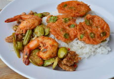 Fried fish patty and spicy stir fried bitter flat bean with shrimp on rice Stock Image
