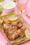 Fried fish Pescado frito with lemon mayonnaise Royalty Free Stock Images