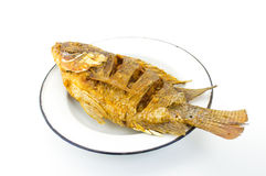 Fried fish. On a plate Royalty Free Stock Photo