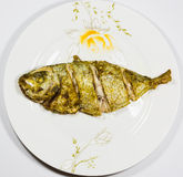 Fried fish on the plate Royalty Free Stock Images