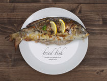 Fried fish on plate Royalty Free Stock Image