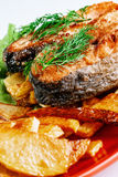 Fried fish with potato chips and greenery Royalty Free Stock Image