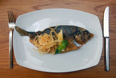 Fried fish with a potato and lemon stock photos