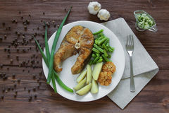 Fried fish with potatoes and asparagus Royalty Free Stock Photo