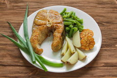 Fried fish with potatoes and asparagus Royalty Free Stock Photos