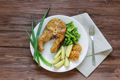Fried fish with potatoes and asparagus Royalty Free Stock Image
