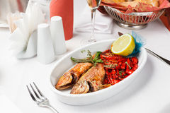 Fried fish with red peppers Royalty Free Stock Image