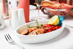 Fried fish with red peppers Stock Photos