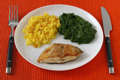 Fried fish with rice and spinach Royalty Free Stock Photos