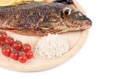 Fried fish with rice and vegetables. Royalty Free Stock Photography