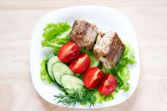 Fried fish with salad Royalty Free Stock Image