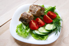 Fried fish with salad Stock Photography