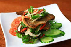 Fried fish salad. Is the Thai spicy salad plate Royalty Free Stock Image