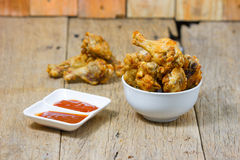 Fried fish sauce marinated chicken drumstick and sauce Royalty Free Stock Photos
