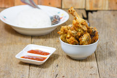 Fried fish sauce marinated chicken drumstick and sauce Royalty Free Stock Images