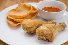 Fried fish sauce marinated chicken drumstick and sauce on white Stock Image