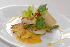 Fried fish sea bass Stock Photos