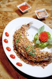Fried fish served with garlic Royalty Free Stock Image