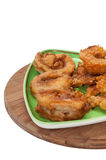 Fried fish served on a green triangular plate Stock Photo