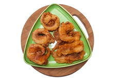 Fried fish served on a green triangular plate Stock Photos