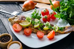The fried fish served on the plate Stock Photo