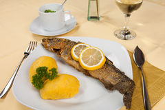 Fried Fish served with side salad, and mash Stock Photos