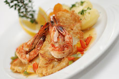 Fried fish with shrimps Stock Images