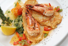 Fried fish with shrimps. Fried sole fosh with shrimps, potatoes, lemon served at restaurant Royalty Free Stock Photos