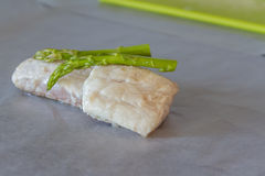 Fried fish slices with asparagus ready for cooking Stock Photos