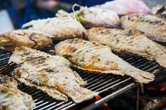 Fried fish is sold at the Asian street  market Stock Image