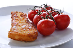 fried fish and some organic tomatoes Stock Photography