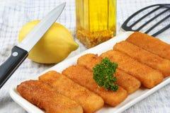 Fried fish sticks on a plate
