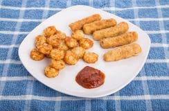 Fried Fish Sticks and Potato Puffs Stock Photo