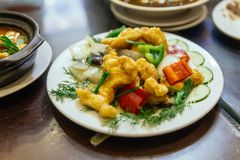 Fried fish stired with onion, mushroom and bell pepper at the restaurant in Hanoi, Vietnam.  Royalty Free Stock Images