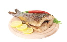 Fried fish tail on wooden table Stock Photos