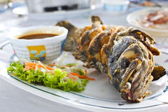 Fried fish with thai spicy seafood sauce Royalty Free Stock Photo